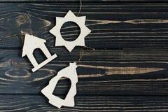 Simple christmas eco toys on stylish black wooden background. sp Royalty Free Stock Image