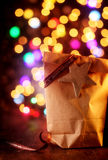 Simple Christmas gift with a colorful party bokeh Stock Photo