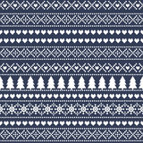 Simple Christmas pattern - Xmas trees, snowflakes on blue background. Royalty Free Stock Photography