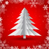 Simple  christmas tree. Greeting card with christmas tree made from pieces of paper on red background Stock Photography