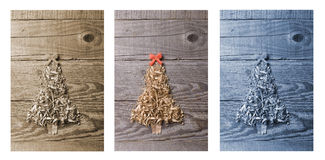Simple Christmas tree arranged from sawdust, wood-chips on woode Royalty Free Stock Photography