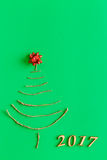 Simple christmas tree on green - original new year card Royalty Free Stock Image