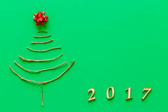 Simple christmas tree on green - original new year card Stock Images
