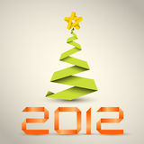 Simple  christmas tree from paper stripe. Simple  christmas tree made from green paper stripe - original new year card Stock Photo