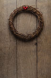 Simple Christmas Twig Wreath Hanging  on Oak Plank Door Royalty Free Stock Images