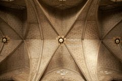 Simple church brick ceiling with lamps. Abstract religious architecture background stock photography
