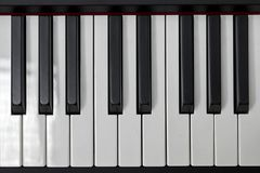 Simple and clean piano keys, one octave, music closeup, space for text on black background royalty free stock photos
