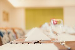 Simple clean white linen elegant table top at fine restaurant dining experience.  stock images