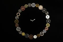 Simple clock made out of little cogwheels. Royalty Free Stock Photography