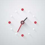 Simple clock with red and white dots Royalty Free Stock Photography