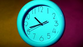 Simple clock or watch on white tile wall stock video