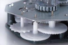 Simple clockwork with plastic gears. Macro photo Stock Image