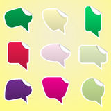 Simple color speak bubbles with symbols stickers Stock Image