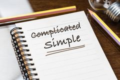 Simple and Complicated. Discard Complicated and underline on Simple, text as memo on notebook for communication concept royalty free stock image