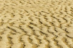 Sand texture at Hervey Bay, QLD. A simple composition of sand and patterns on the coast of Hervey Bay, Queensland Australia stock photography