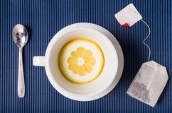 Simple composition with tea cup empty but with slice of lemon, s Royalty Free Stock Images