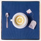 Simple composition with tea cup empty but with slice of lemon, s Stock Photos