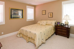 Simple coral color bedroom. With carpet stock photo