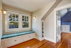Simple cozy sitting room interior in the attic. Stock Image