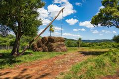 Simple crane device for loading sugarcane on trucks in Paraguay royalty free stock photo