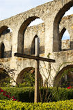 Simple cross in courtyard. Simple wooden cross in courtyard stock photo