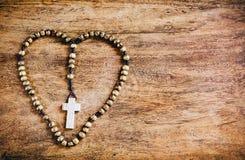 Simple Cross Inside Heart Shape - Rustic Stock Photo