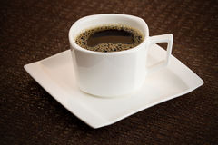Simple dark coffee cup with brew Royalty Free Stock Photo