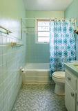 Simple dated 1950s bathroom. Royalty Free Stock Photography