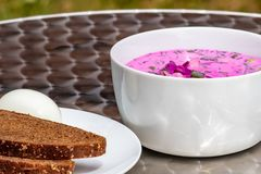 Simple delicious chilled beetroot Gazpacho with dark bread and egg stock photography