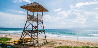 Simple design of lifeguard house on cloudy blue sky and Andaman royalty free stock photography