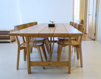 Simple dining room. With wooden furniture stock images
