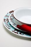 Simple dinnerware setting. A simple dinnerware setting of two plates a bowl and a napkin Stock Images