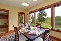 Simple dinning room with large windows. Royalty Free Stock Photography