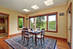 Simple dinning room with large windows. Stock Images