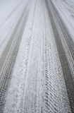 Simple dirty snowy car tracks - portrait Royalty Free Stock Image