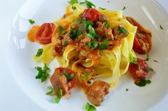 Pasta with mushrooms and tomatoes stock images