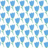 Simple doodle blue tulip pattern. Cute flower seamless background. Summer wallpaper. Stock Photography