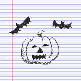Simple doodle of a pumpkin and bats Royalty Free Stock Images