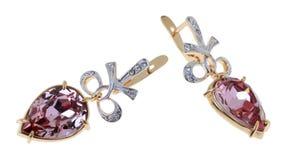 Simple earrings Royalty Free Stock Photos