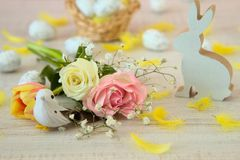 Beautiful easter table decoration with painted eggs ,rabbits and flowers in pastel colors. Simple easter decoration with eggs,feathers, bunny toy and spring royalty free stock photos