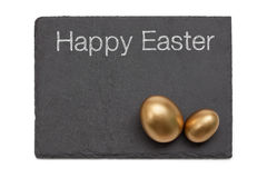 Simple Easter Slate with Golden Eggs Royalty Free Stock Photos