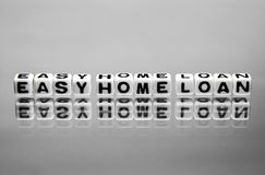 Simple easy home loan. Message on the reflective surface stock image