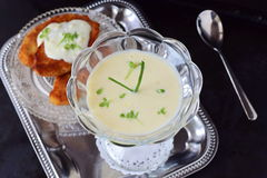 Simple easy to cook milk based gravy in a glass on a metal tray. Healthy food concept. Simple easy to cook milk based gravy in a glass on a metal tray. Healthy Royalty Free Stock Photo