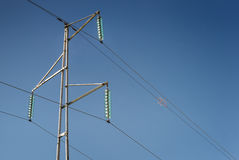 Simple electricity pylon with wires and insulators stock images