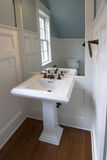 Simple elegant bathroom. Simple yet elegant watercloset with detailed woodwork Royalty Free Stock Image