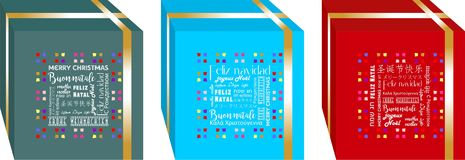 Simple and elegant Christmas gifts boxes, decorated with golden ribbon around it and `Merry Christmas` written in several language. S 1 Stock Photo