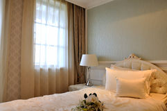 Simple and elegant interior of bedroom. Window curtain with lighting and interior fine decoration of bedroom, shown as simple and elegant decoration style and Royalty Free Stock Photos