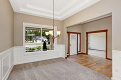 Simple empty room with lots of space and carpet. Royalty Free Stock Photography