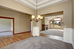 Simple empty room with lots of space and carpet. Stock Image