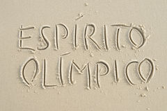 Simple Espirito Olimpico Message Handwritten on Sand Beach Royalty Free Stock Photography